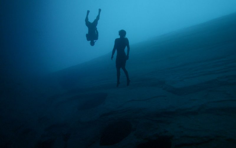 figure diving underwater