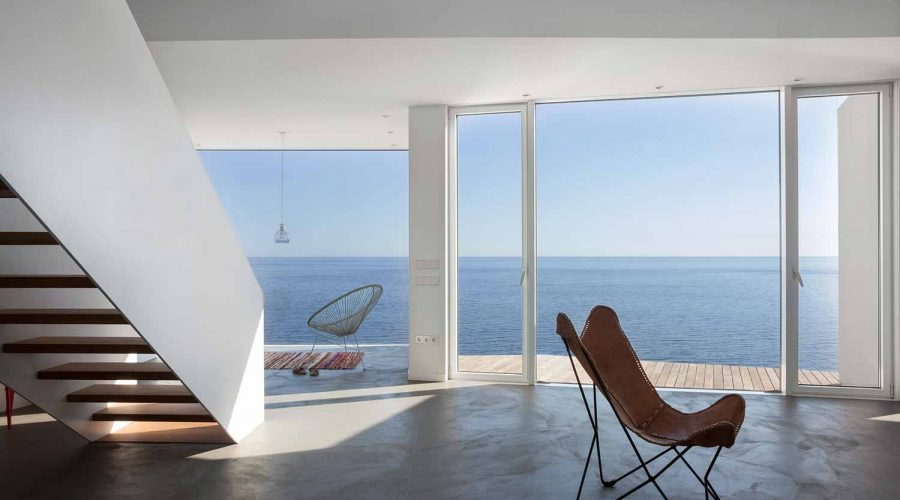 The Sunflower House in Spain - Modern coastal architecture staircase and sea view | SEIKK Magazine