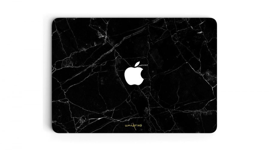 Marble Finished macbook cover in black laptop overhead view