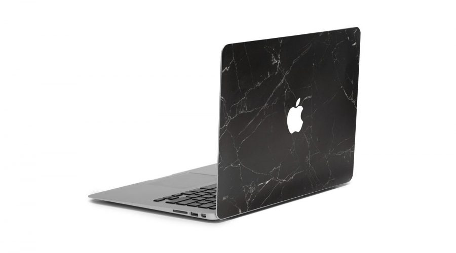 Marble Finished macbook cover in black 3/4 laptop view