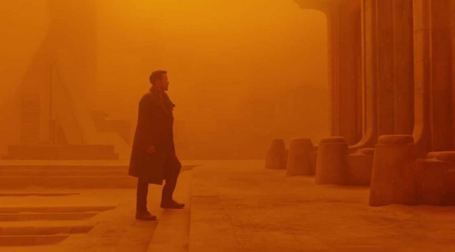 blade runner 2049 film photo with Ryan Gosling Blade Runner actor in a long coat and boots
