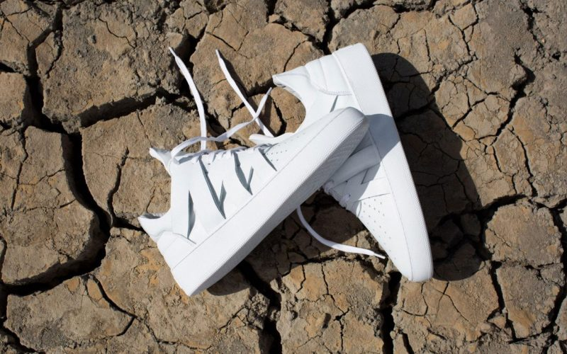 filling pieces sneakers african lookbook white shoes on cracked mud surface