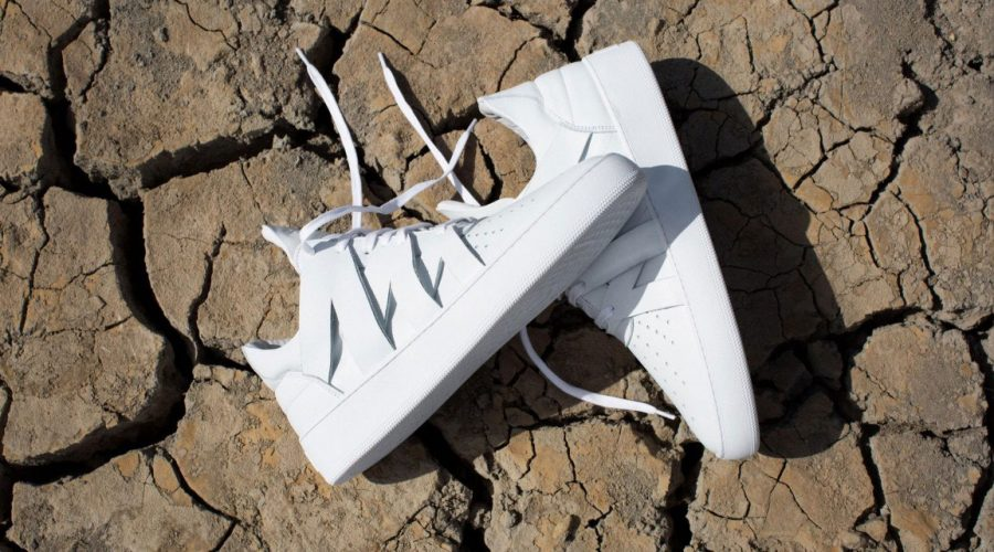 Filling pieces sneakers African lookbook - white shoes on mud | SEIKK Magazine
