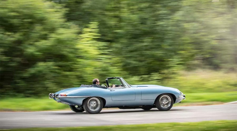 electric jaguar e-type zero car light blue driving side view