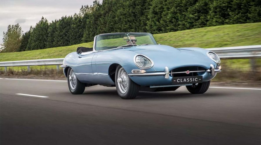 electric jaguar e-type zero car light blue driving