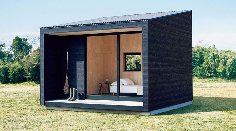 MUJI Micro Huts Modern Cabins - Cabin in landscape 3/4 front view