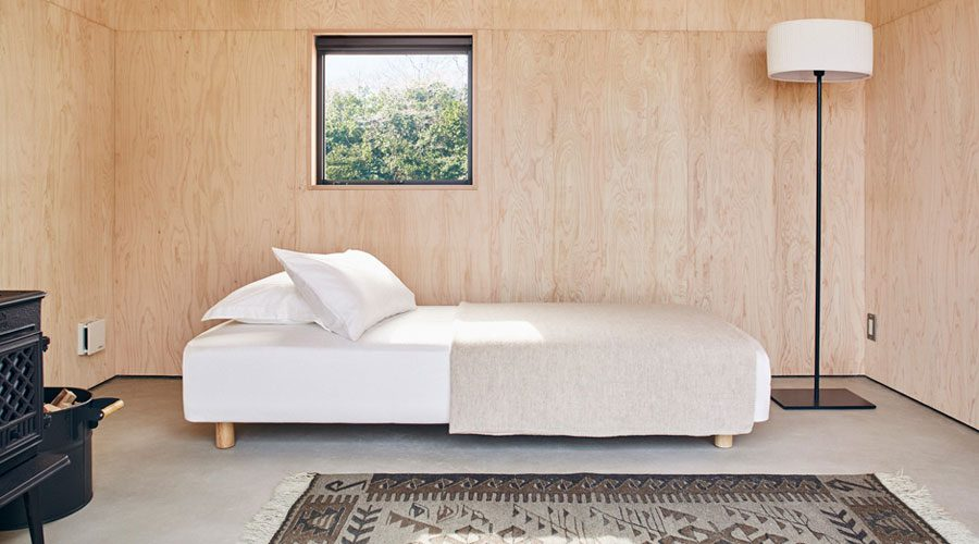 MUJI Micro Huts Modern Cabins - minimalist Cabin interior with bed