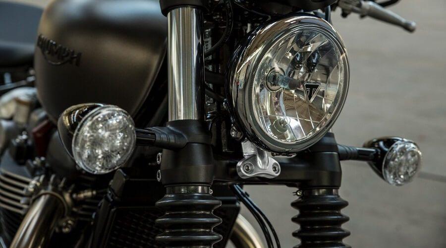 Triumph Bonnerville Bobber Motorcycle - black custom triumph bobber motorbike UK big headlight | SEIKK Magazine