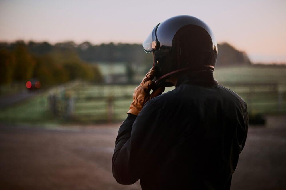 Lions Den Motorcycles UK Biker In Riding Gear With Black Motorbike Helmet