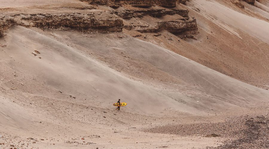 unleash surf peru surfer desert surfing by cathbe - Playa Chicama the worlds longest left wave