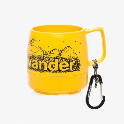 and Wander yellow Dinex logo mug