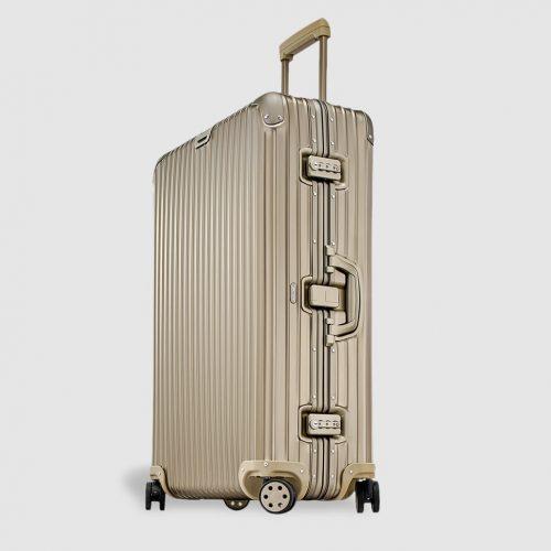 MensRimowa TOPAS TITANIUM Large Suitcase in Gold