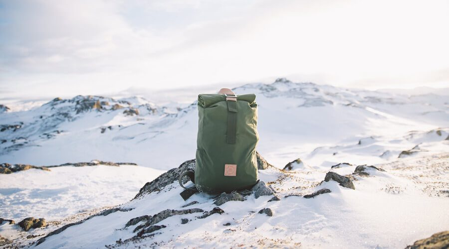 The Level Collective Ethical Outdoor Clothing - Green Backpack On Arctic Mountain | SEIKK Magazine