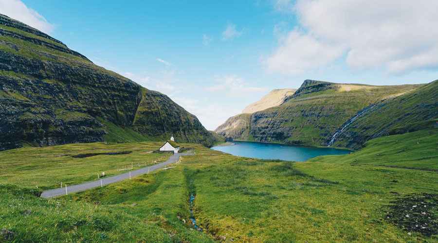 Surfing In The Faroe Islands Guide - Bentley Bentayga Faroes Surfing Saksun Church Landscape | SEIKK Magazine