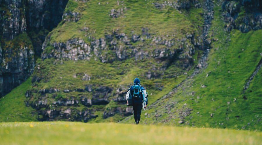 Surfing In The Faroe Islands Guide - Bentley Bentayga Faroes Surfing Surfer Walking | SEIKK Magazine